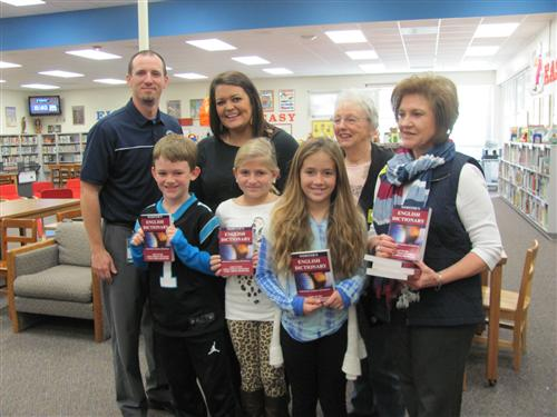 Rotary Members present dictionaries