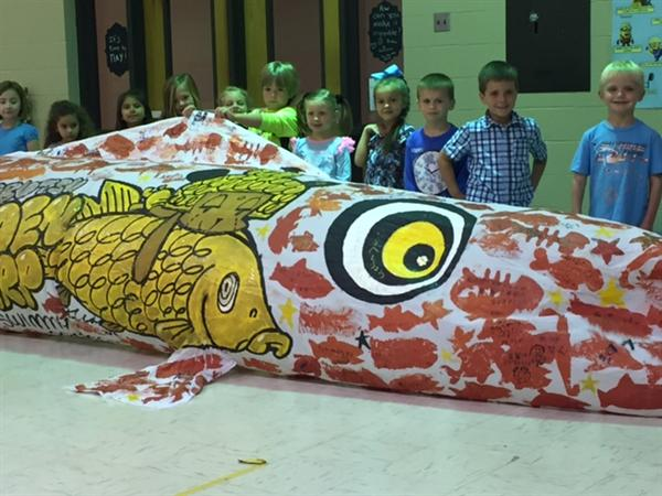 """Making Giant Koinobori with Small Fish by Small Hands of Children Around the World."" A global project celebrating children in Japan!"