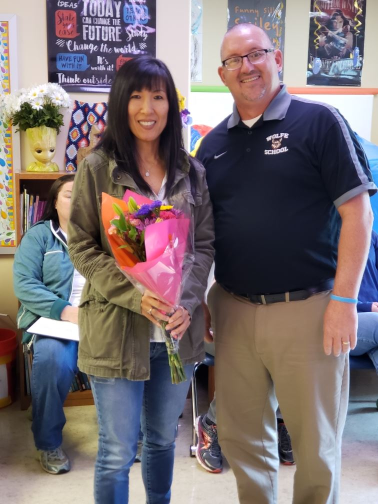 Ms. Sue Lee receives Teacher of the Year recognition