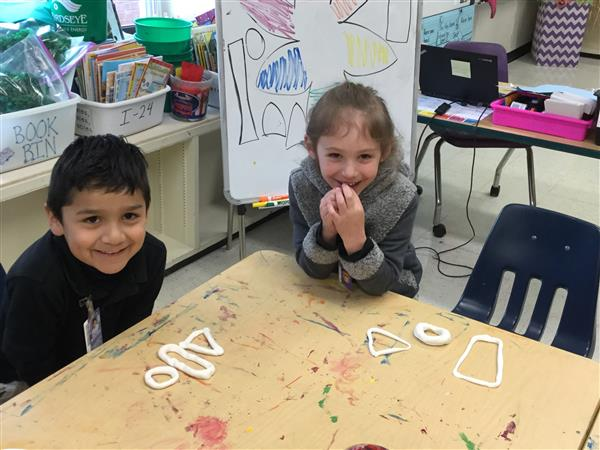 Kindergarten enjoys creating geometric shapes with clay in art