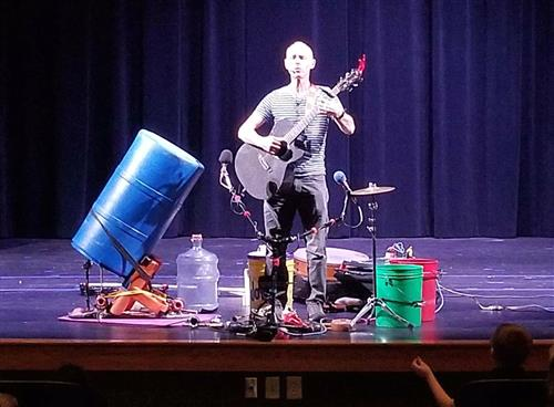 Mr. Billy Jonas is pictured with musical instruments from recycled objects.