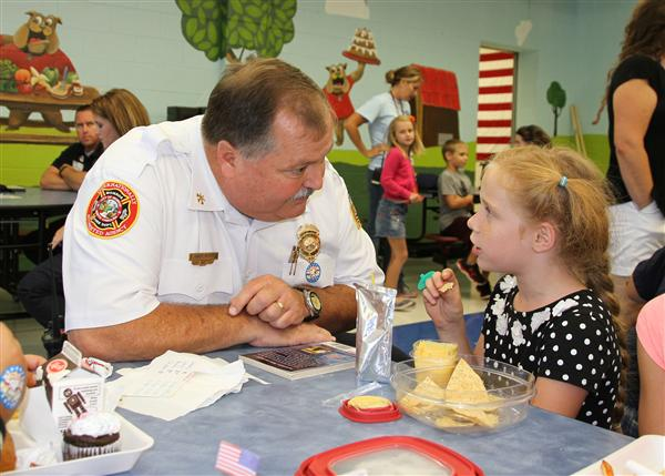 Monroe Fire Battalion Chief Andy Ross talks to a student.